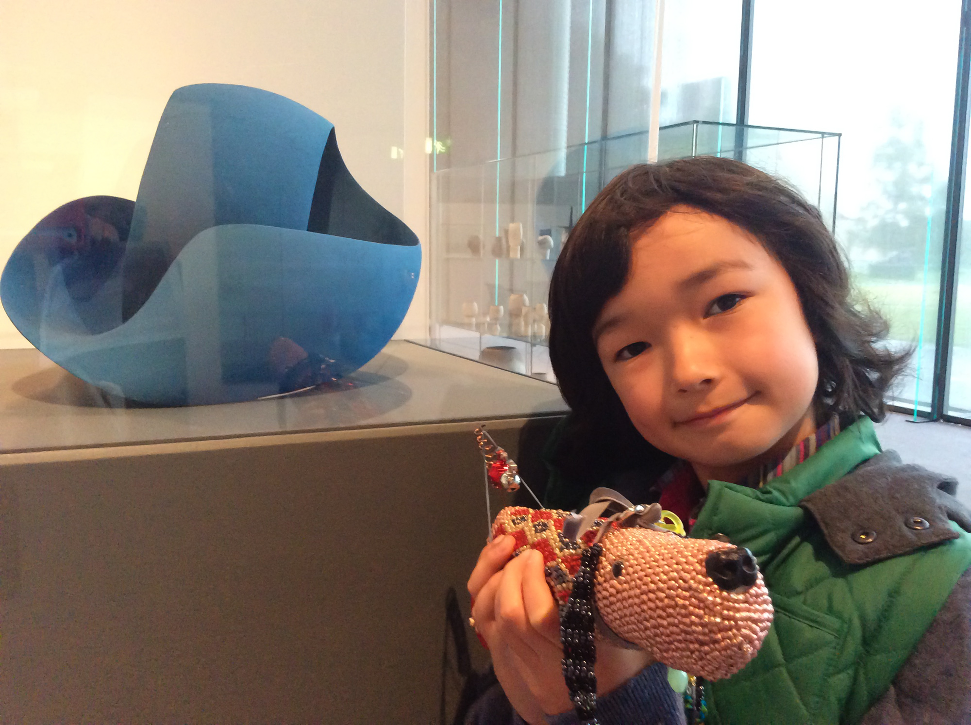 He found this abstract blue sculpture interesting and wants to find out more